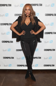 Tyra Banks wrapped up her curves in a fitted V-neck blouse for the Cosmopolitan Fun Fearless Money 2016.