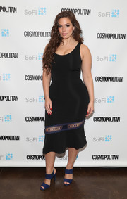 Ashley Graham styled her dress with a pair of blue broad-strap heels.