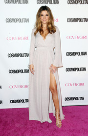 Maria Menounos looked diva-ish in a pale gray maxi dress with a plunging neckline and a thigh-baring slit during Cosmopolitan's 50th birthday celebration.