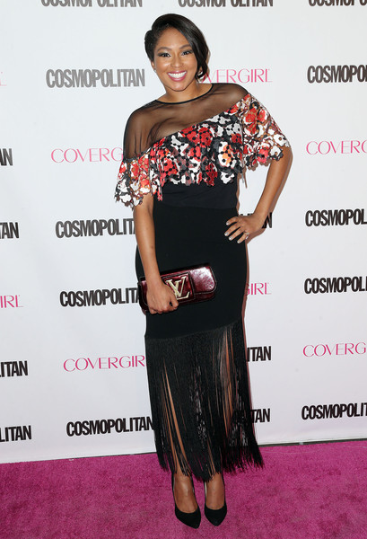A metallic red clutch by Louis Vuitton sealed off Alicia Quarles' look.
