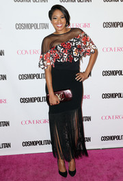 Alicia Quarles paired her blouse with a fringed black maxi skirt.
