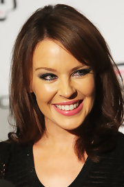 Kylie Minogue wore a bright bubblegum pink lipstick coated with a sweep of subtly shimmering gloss at the 2011 'Cosmopolitan' Ultimate Women of the Year Awards.