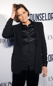 Sigourney Weaver opted for a menswear-inspired look with this all-black blazer, button-down, and slacks combo at the screening of 'The Counselor.'