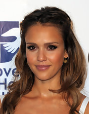 Jessica Alba paired her half up hairstyle with gold dangle earrings for the Covenant House Gala.