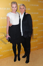 Portia kept her minimalist look intact with a black satin clutch.