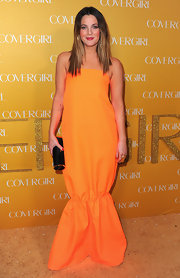 Drew opted for a bright hue with this orange floor sweeping dress.