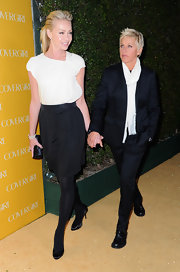 Portia looks sophisticated in a white blouse and black skirt.