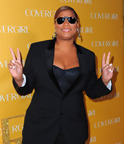 Queen Latifah wears her sunglasses at night...silver aviators to be specific.