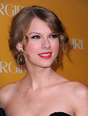 Taylor Swift paired her pinned up ringlets with ornate dangling earrings.