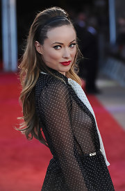 Olivia Wilde looked fun and flirty at the 'Cowboys and Aliens' UK premiere in a black and white polka dot dress. She paired the look with long wavy tresses, teased at the crown and accessorized with a black headband.