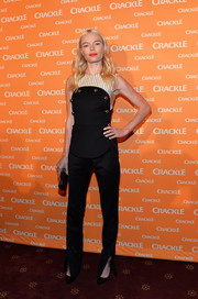 Kate Bosworth teamed her top with a pair of black pants with split ankles, also by Monse.