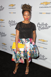 Monique Coleman added a burst of color with a flared print skirt.