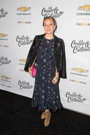 Jennifer Meyer toughened up her dress with a black leather biker jacket.