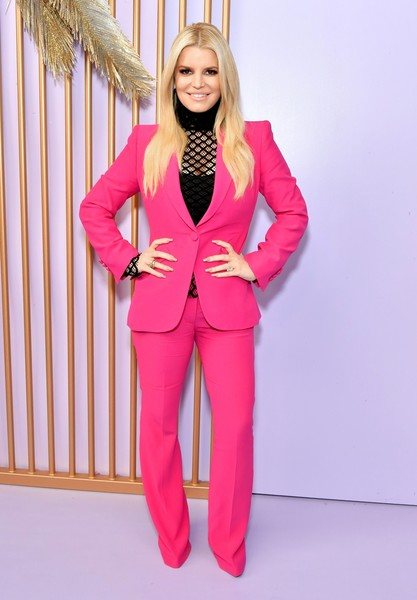 Jessica Simpson teamed a fuchsia Alexander McQueen pantsuit with a black mesh turtleneck for the Create & Cultivate Los Angeles event.