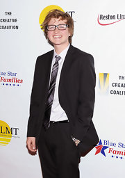 Angus T. Jones looked stylish at the Salute to Blue Star Families in a black suit and plaid tie.