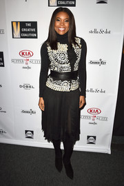 Gabrielle Union layered an Altuzarra mother-of-pearl-embellished vest over a black turtleneck for the Creative Coalition Spotlight Initiative Awards.
