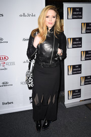 Natasha Lyonne amped up the edge factor in a black leather biker jacket during the Creative Coalition Spotlight Initiative Awards.