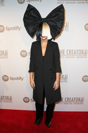 Sia donned a double-breasted black coat (and her signature wig, of course) for the Creators party.
