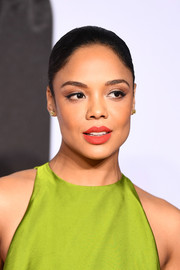 Tessa Thompson's red lipstick looked gorgeous against her chartreuse outfit.