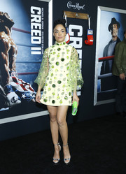 Tessa Thompson paired her dress with silver ankle-strap platforms.