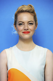 Emma Stone is not one to shy away from a bright lip, as she showed here where she opted for a red lip with an orange undertone.