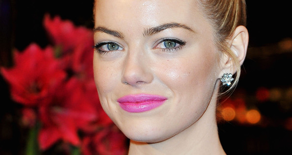 Emma Stone proves she's not one to shy away from a bright lip with this bubblegum pink lip color.