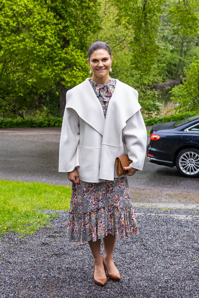Princess Victoria teamed brown pumps by Gianvito Rossi with a floral dress and a swing jacket for the annual meeting of the Nordic Museum and Skansen & Friends.