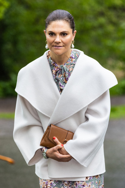 Princess Victoria accessorized with a classic brown leather clutch at the annual meeting of the Nordic Museum and Skansen & Friends.