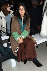 Leandra Medine was spotted at the Cushnie Et Ochs fashion show all bundled up in a color-block fleece coat and a brown maxi skirt.