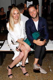 Lauren Santo Domingo attended the Cushnie et Ochs fashion show wearing tricolor patent sandals with a white dress.