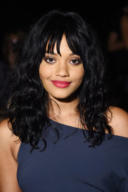 Kiersey Clemons sported high-volume curls with wispy bangs when she attended the Cushnie et Ochs fashion show.