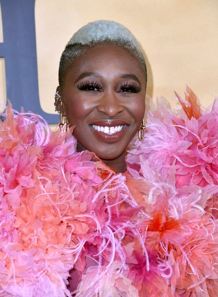 Cynthia Erivo Fauxhawk [face,pink,feather boa,head,orange,beauty,smile,fun,lip,happy,arrivals,harriet,cynthia erivo,california,los angeles,the orpheum theatre,focus features,premiere,premiere]