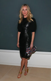 Rebecca Romijn wore a leather clad dress to the Cynthia Rowley show in NY.