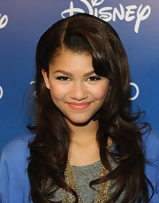Zendaya wore her wavy locks in a deep side part.