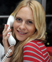 Poppy Delevingne showed off her red mani while working the phones at the DEC Philippines typhoon appeal.