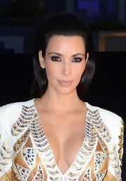 Kim Kardashian wore her hair in a voluminous slicked-back style while attending the Cannes Film Festival.