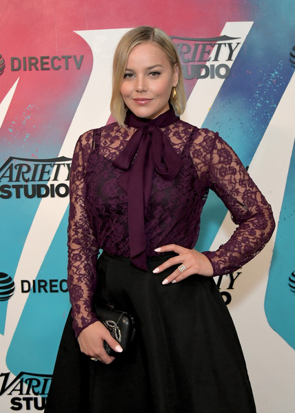 Abbie Cornish stopped by DIRECTV House carrying a black clutch with silver embroidery.