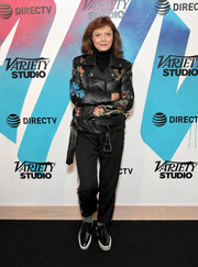 Susan Sarandon teamed a floral leather jacket with side-striped pants for her visit to DIRECTV House.