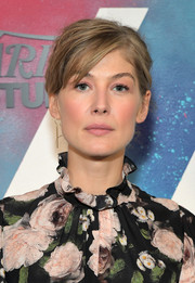 Rosamund Pike visited DIRECTV House wearing her hair in a messy updo.