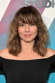 Linda Cardellini framed her face with messy waves and eye-grazing bangs for her visit to DIRECTV House.