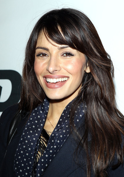 Sarah Shahi wore long straight locks to a Superbowl party.