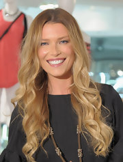 Veronica Varekova attended International Women's Day in NYC wearing her long golden locks in bouncy spiral curls.