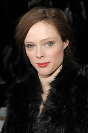 Coco Rocha wore her hair in a casually styled updo at the DKNY fall 2012 fashion show.