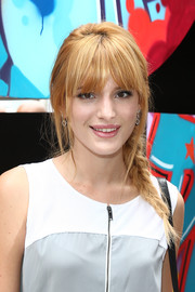 Bella Thorne looked romantic at the DKNY fashion show with her messy-chic loose braid.