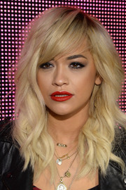 Rita Ora wore her hair in an edgy-glam wavy 'do with side-swept bangs during the DKNY fashion show.