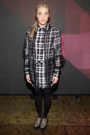 Mia Moretti attended the DKNY fashion show wearing a plaid shirtdress with a sheer black coverup.