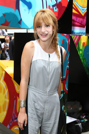 Bella Thorne spruced up her jumpsuit with a stylish silver cuff bracelet when she attended the DKNY fashion show.