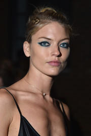 Martha Hunt topped off her look with a knotty updo when she attended the DKNY fashion show.