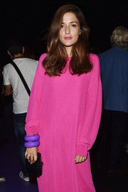 Eleonora Carisi's oversized purple bangles made a nice color contrast to her pink dress.