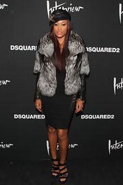 A thick fur coat topped off Eve's ensemble in luxe style at the premiere of 'Behind the Mirror.'